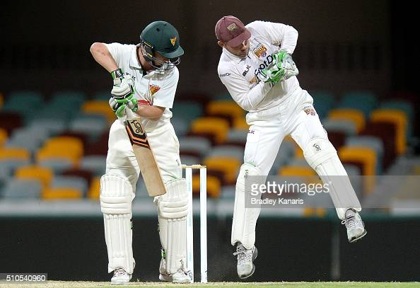 Chris Hartley of Queensland catches out Jake Doran of Tasmania during day three of the Sheffield Shield match between Queensland and Tasmania at The...