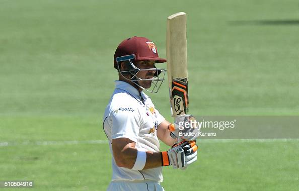 Chris Hartley of Queensland celebrates scoring a half century during day three of the Sheffield Shield match between Queensland and Tasmania at The...