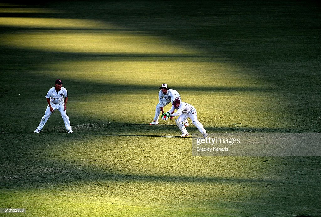 <a gi-track='captionPersonalityLinkClicked' href=/galleries/search?phrase=Chris+Hartley&family=editorial&specificpeople=185229 ng-click='$event.stopPropagation()'>Chris Hartley</a> of Queensland wicketkeeps during day one of the Sheffield Shield match between Queensland and Tasmania at The Gabba on February 14, 2016 in Brisbane, Australia.