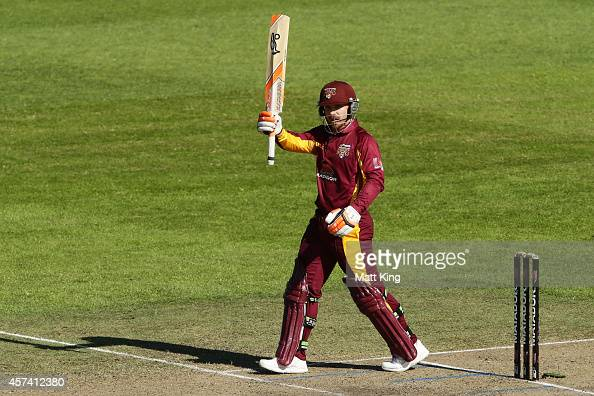 Chris Hartley of the Bulls celebrates and acknowledges the crowd after scoring a century during the Matador BBQs One Day Cup match between Queensland...