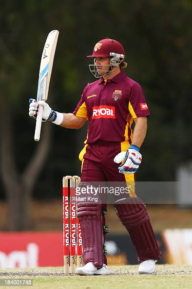 Chris Hartley of the Bulls celebrates scoring a half century during the Ryobi Cup match between the Queensland Bulls and the Western Australia...