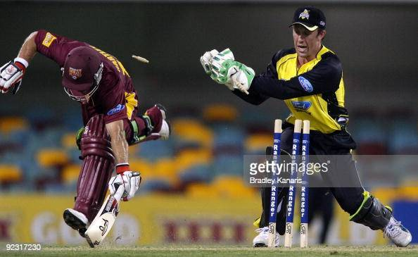 Chris Hartley of the Bulls makes his ground as wicketkeeper Luke Ronchi of the Warriors attempts to run him out during the Ford Ranger Cup match...