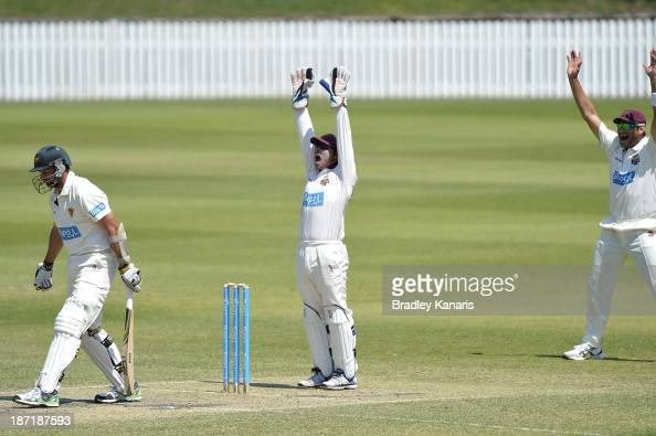 Chris Hartley of the Bulls successfully appeals for the wicket of Ben Hilfenhaus of the Tigers losing his wicket LBW to Cameron Boyce of the Bulls...