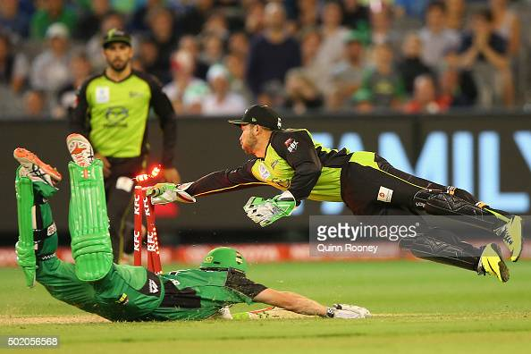 Chris Hartley of the Thunder attempts to run out James Faulkner of the Stars during the Big Bash League match between Melbourne Stars and Sydney...