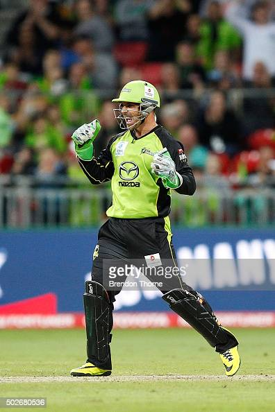 Chris Hartley of the Thunder celebrates after the wicket of Michael Neser of the Strikers during the Big Bash League match between the Sydney Thunder...