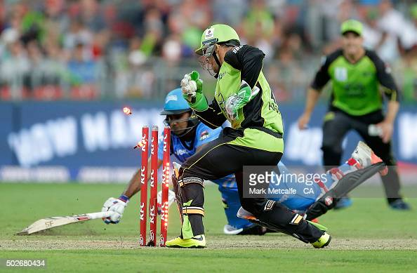Chris Hartley of the Thunder knocks off the bails to dismiss Mahela Jayawardena of the Strikers by runout during the Big Bash League match between...