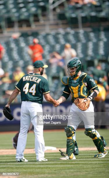 Chris Hatcher and Dustin Garneau of the Oakland Athletics celebrate on the field following the game against the Los Angeles Angels of Anaheim at the...