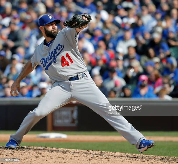 Chris Hatcher of the Los Angeles Dodgers pitches against the Chicago Cubs during the seventh inning at Wrigley Field on April 13 2017 in Chicago...