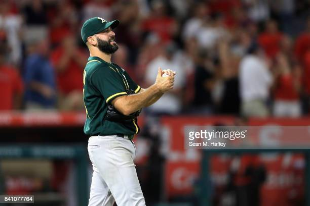 Chris Hatcher of the Oakland Athletics looks on after allowing a grandslam homerun to Cliff Pennington of the Los Angeles Angels during the seventh...