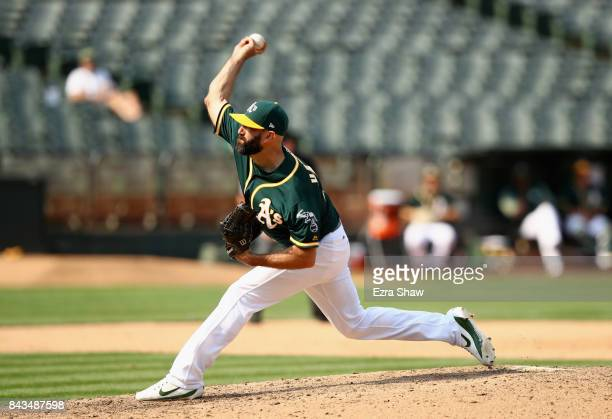 Chris Hatcher of the Oakland Athletics pitches against the Los Angeles Angels in the ninth inning at Oakland Alameda Coliseum on September 6 2017 in...