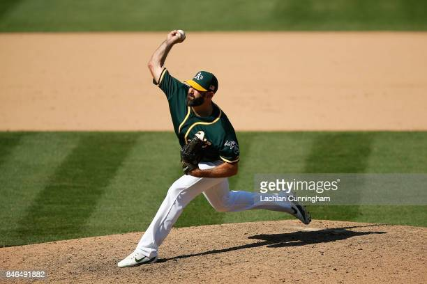 Chris Hatcher of the Oakland Athletics pitches in the eighth inning against the Houston Astros at Oakland Alameda Coliseum on September 10 2017 in...
