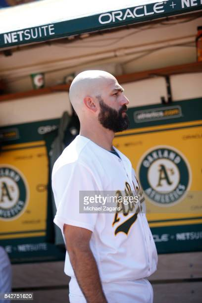 Chris Hatcher of the Oakland Athletics stands in the dugout during the game against the Kansas City Royals at the Oakland Alameda Coliseum on August...