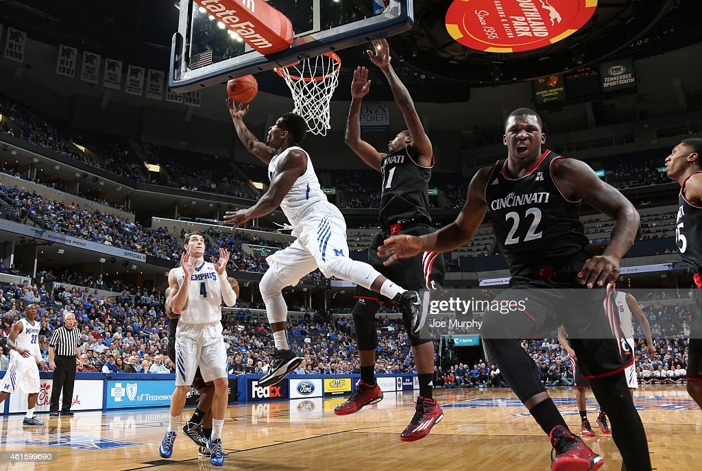 Chris Hawkins of the Memphis Tigers shoots a reverse layup against Gary Clark as Coreontae DeBerry of the Cincinnati Bearcats reacts on January 15...