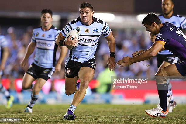 Chris Heighington of the Sharks runs the ball during the round four NRL match between the Cronulla Sharks and the Melbourne Storm at Southern Cross...