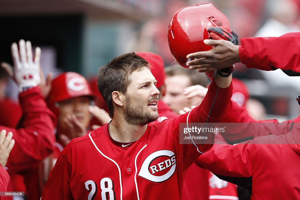 Chris Heisey #28 celebrates after hitting a two-run homer in the fifth inning of the game against the Los Angeles Angels of Anaheim at Great American Ball Park on April 4, 2013 in Cincinnati, Ohio. The Reds won 5-4.