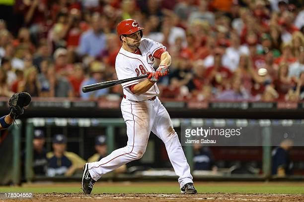 Chris Heisey of the Cincinnati Reds bats against the Milwaukee Brewers at Great American Ball Park on August 24 2013 in Cincinnati Ohio