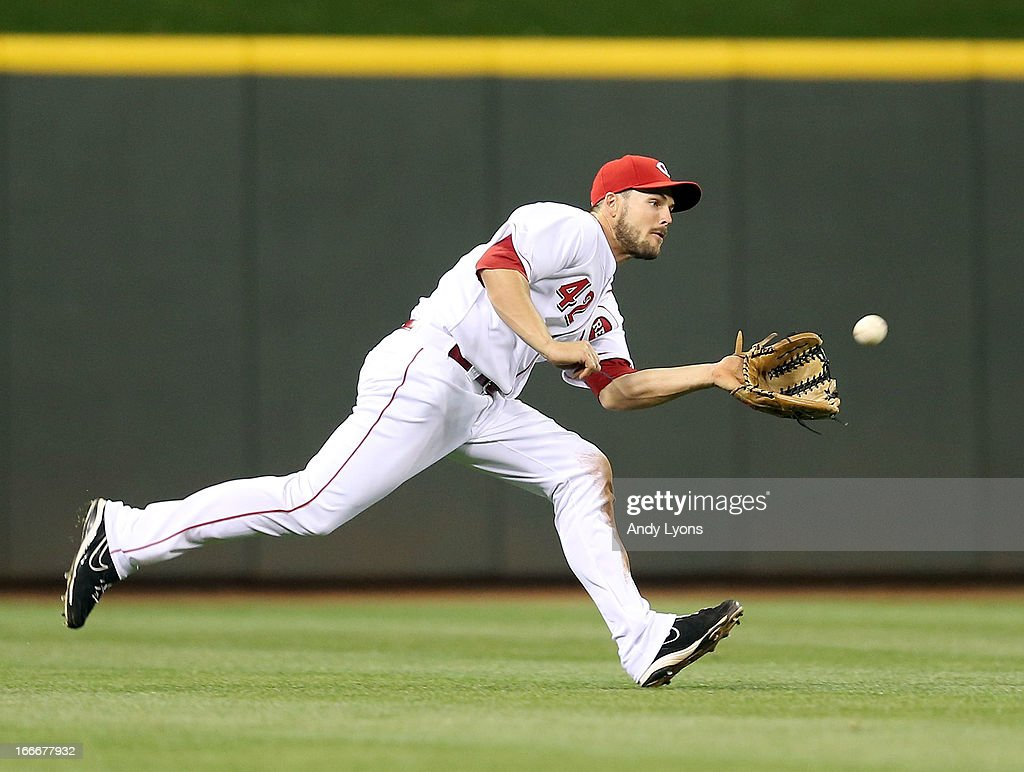 <a gi-track='captionPersonalityLinkClicked' href=/galleries/search?phrase=Chris+Heisey&family=editorial&specificpeople=5971787 ng-click='$event.stopPropagation()'>Chris Heisey</a> of the Cincinnati Reds catches a ball hit by Freddy Galvis in the 9th inning during the game against the Philadelphia Phillies at Great American Ball Park on April 15, 2013 in Cincinnati, Ohio. All uniformed team members are wearing jersey number 42 in honor of Jackie Robinson Day.