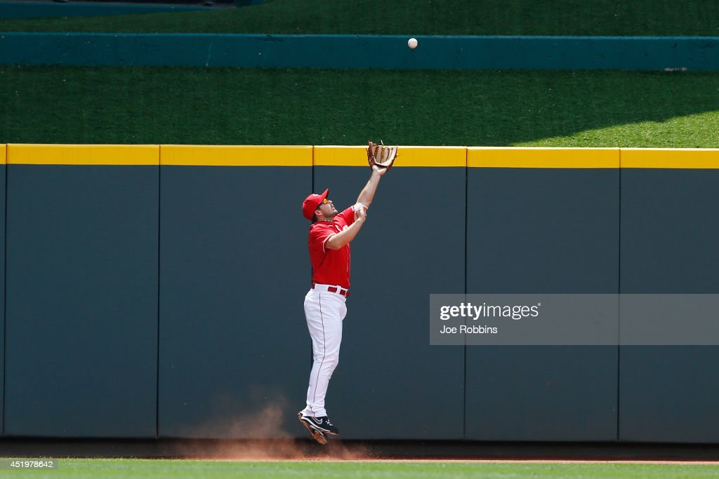 <a gi-track='captionPersonalityLinkClicked' href=/galleries/search?phrase=Chris+Heisey&family=editorial&specificpeople=5971787 ng-click='$event.stopPropagation()'>Chris Heisey</a> #28 of the Cincinnati Reds catches a fly ball against the center field fence in the first inning of the game against the Chicago Cubs at Great American Ball Park on July 10, 2014 in Cincinnati, Ohio.