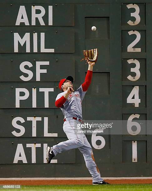 Chris Heisey of the Cincinnati Reds catches a fly ball hit by Shane Victorino of the Boston Red Sox in the 7th inning during the interleague game at...