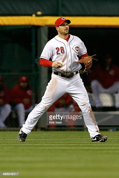 Chris Heisey of the Cincinnati Reds fields the ball during the game against the Milwaukee Brewers at Great American Ball Park on May 2 2014 in...