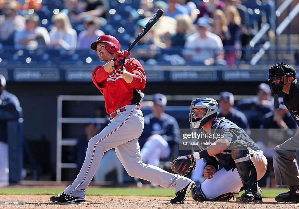 <a gi-track='captionPersonalityLinkClicked' href=/galleries/search?phrase=Chris+Heisey&family=editorial&specificpeople=5971787 ng-click='$event.stopPropagation()'>Chris Heisey</a> #28 of the Cincinnati Reds hits a RBI triple against the San Diego Padres during the third inning of the spring training game at Peoria Stadium on February 26, 2013 in Peoria, Arizona.