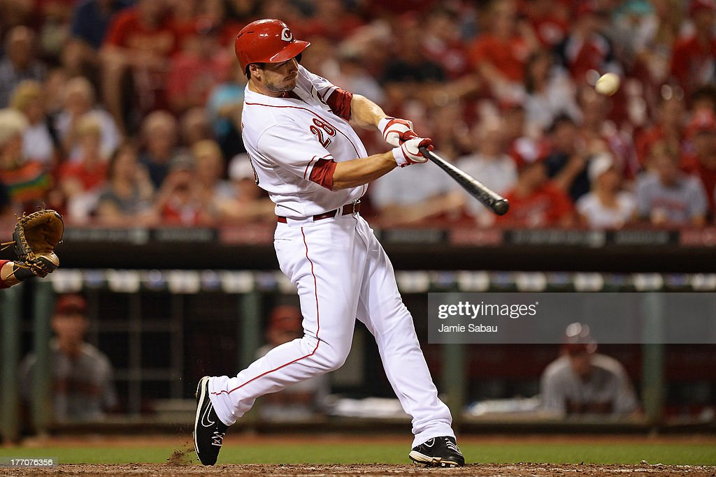 Chris Heisey #28 of the Cincinnati Reds hits a two-run home run in the eighth inning against the Arizona Diamondbacks at Great American Ball Park on August 20, 2013 in Cincinnati, Ohio. Arizona defeated Cincinnati 5-2.