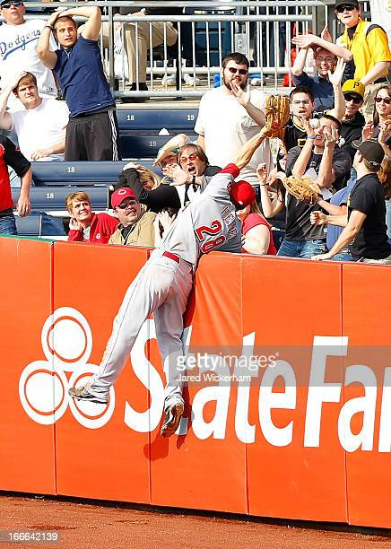 Chris Heisey of the Cincinnati Reds just misses catching a tworun home run by Michael McKenry of the Pittsburgh Pirates that tied the game at 6 runs...