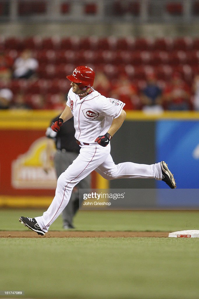 <a gi-track='captionPersonalityLinkClicked' href=/galleries/search?phrase=Chris+Heisey&family=editorial&specificpeople=5971787 ng-click='$event.stopPropagation()'>Chris Heisey</a> #28 of the Cincinnati Reds rounds the bases after connecting for a home run during the game against the Pittsburgh Pirates at Great American Ball Park on September 10, 2012 in Cincinnati, Ohio. The Reds defeated the Pirates 4-3 in 14 innings.