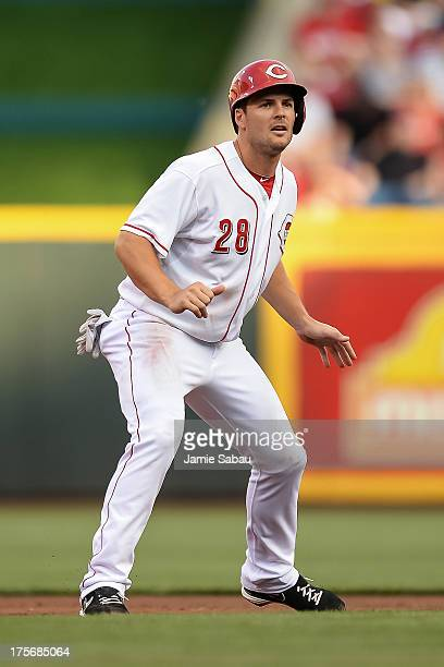 Chris Heisey of the Cincinnati Reds runs the bases against the St Louis Cardinals at Great American Ball Park on August 3 2013 in Cincinnati Ohio