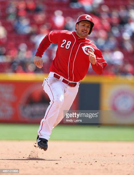 Chris Heisey of the Cincinnati Reds runs to third base during the game against the Pittsburgh Pirates at Great American Ball Park on April 16 2014 in...
