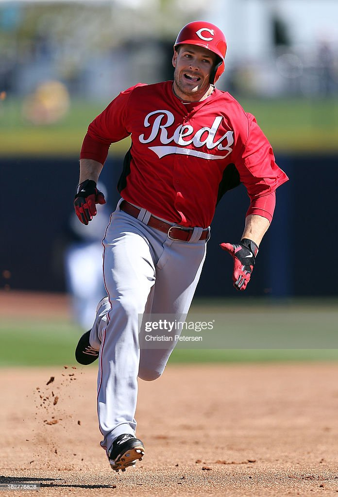 <a gi-track='captionPersonalityLinkClicked' href=/galleries/search?phrase=Chris+Heisey&family=editorial&specificpeople=5971787 ng-click='$event.stopPropagation()'>Chris Heisey</a> #28 of the Cincinnati Reds runs to third base on his triple during the third inning of the spring training game against the San Diego Padres at Peoria Stadium on February 26, 2013 in Peoria, Arizona.
