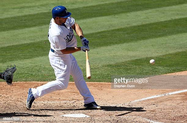 Chris Heisey of the Los Angeles Dodgers hits a grand slam home run in the fifth inning to give the Dodgers a 63 lead against the Arizona Diamondbacks...