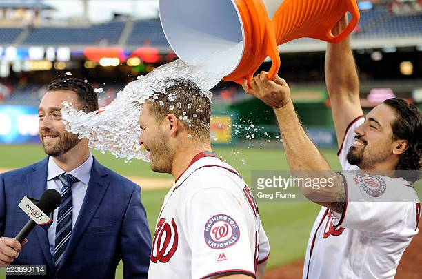 Chris Heisey of the Washington Nationals is doused with water by Anthony Rendon after hitting the gamewinning home run in the 16th inning against the...