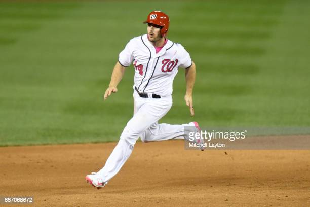 Chris Heisey of the Washington Nationals runs to third base during game two of baseball game against the Philadelphia Phillies at Nationals Park on...