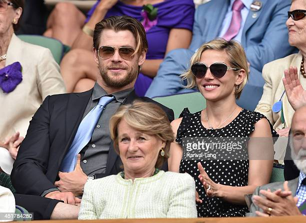Chris Hemsworth and Elsa Pataky attend the mens singles final between Novak Djokovic and Roger Federer on centre court during day thirteen of the...