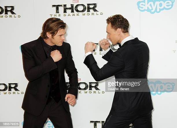 Chris Hemsworth and Tom Hiddleston attend the World Premiere of 'Thor The Dark World' at Odeon Leicester Square on October 22 2013 in London England