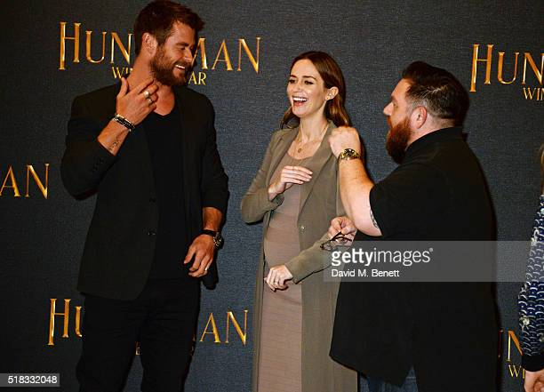 Chris Hemsworth Emily Blunt and Nick Frost pose at a photocall for 'The Huntsman Winter's War' at Claridges Hotel on March 31 2016 in London England