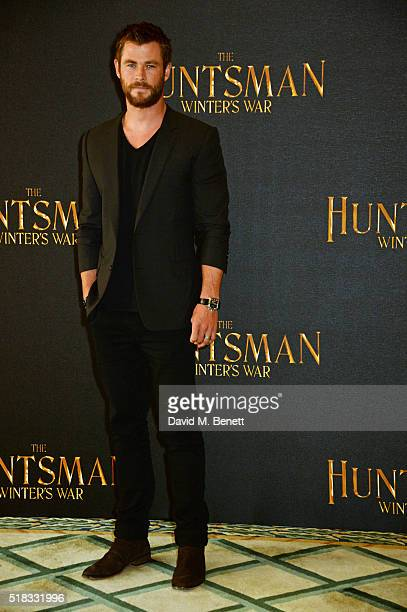 Chris Hemsworth poses at a photocall for 'The Huntsman Winter's War' at Claridges Hotel on March 31 2016 in London England