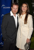 Chris Henchy and wife actress Brooke Shields arrive to the annual Oceana Partner's Awards Gala honoring former Vice President Al Gore at the home of...