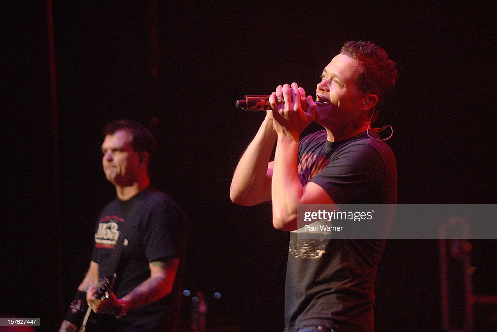 Chris Henderson (L) and Brad Arnold of Three Doors Down perform with the band at Fox theater on December 5, 2012 in Detroit, Michigan.