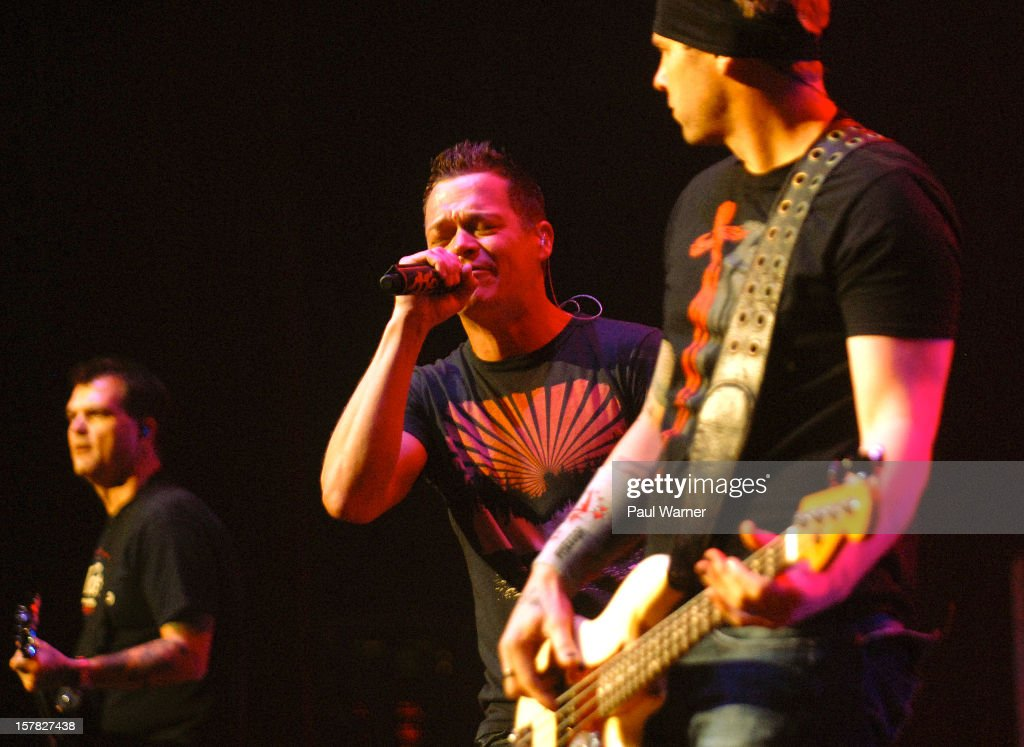 Chris Henderson, Brad Arnold and Todd Harrell of Three Doors Down perform with the band at Fox theater on December 5, 2012 in Detroit, Michigan.
