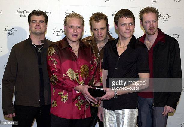 Chris Henderson Todd Harrell Matt Roberts Brad Arnold Rich Liles of the group 3 Doors Down pose with their award for Favorite New Pop/Rock Artist at...