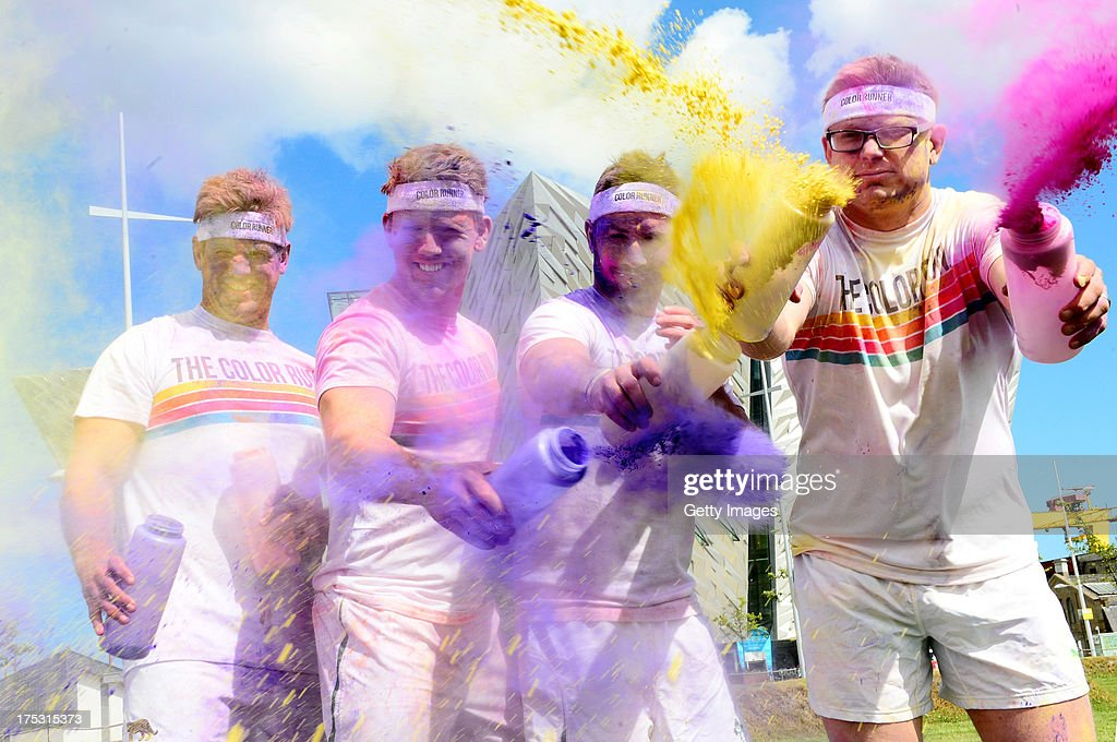 Chris Henry, Craig GIlroy, Paddy Wallace of Ulster Rugby Club and Tom Wallace (British Lion) promote The Colour Run presented by Dulux on August 2, 2013 in Belfast Ireland. known as the happiest 5km on the planet, on August 24 in Belfast. Runners of all shapes, sizes and speeds wearing white clothing that is a blank canvas for the kaleidoscope of colours they encounter around The Colour Run course. At each kilometer a different colour of powder is thrown in the air with the runners becoming a constantly evolving artwork. At the end of the course runners are greeted by the Colour Festival where the air is filled with music and stunning colour powder bursts creating a vibrant party atmosphere. www.thecolourrun.co.uk [media contact alex.coulson@img.com] on August 2nd 3012 in Belfast Northern Ireland. Color Run Belfast with Ulster Rugby