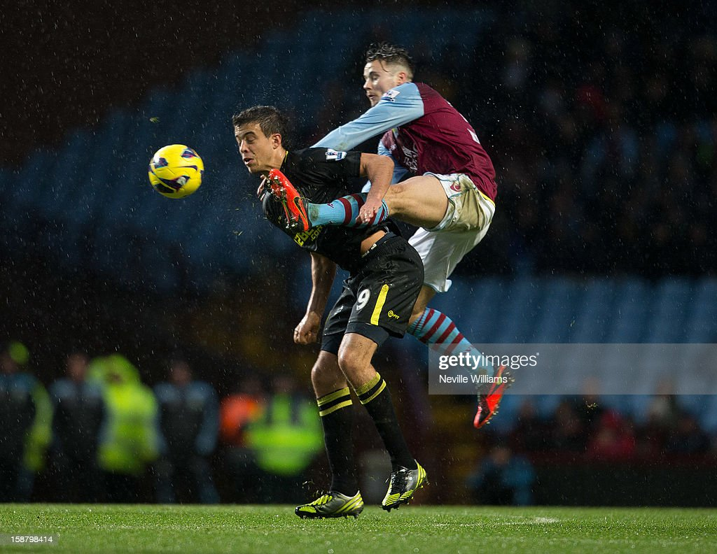 Chris Herd of Aston Villa challenges Franco Di Santo of Wigan Athletic during the Barclays Premier League match between Aston Villa and Wigan Athletic at Villa Park on December 29, 2012 in Birmingham, England.