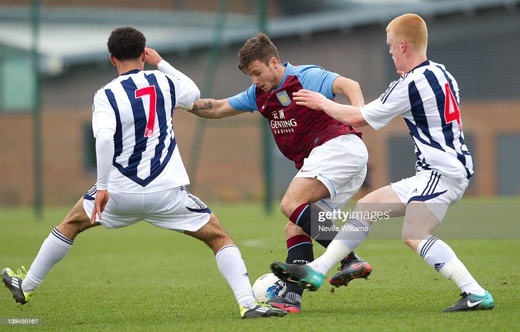 Chris Herd of Aston Villa is challenged by Kemar Roofe of West Bromwich Albion with team mate Liam O'Neil during the Barclays Premier Reserve League match between Aston Villa Reserves and West Bromwich Albion Reserves at the club's training ground at Bodymoor Heath on February 21, 2012 in Birmingham, England.