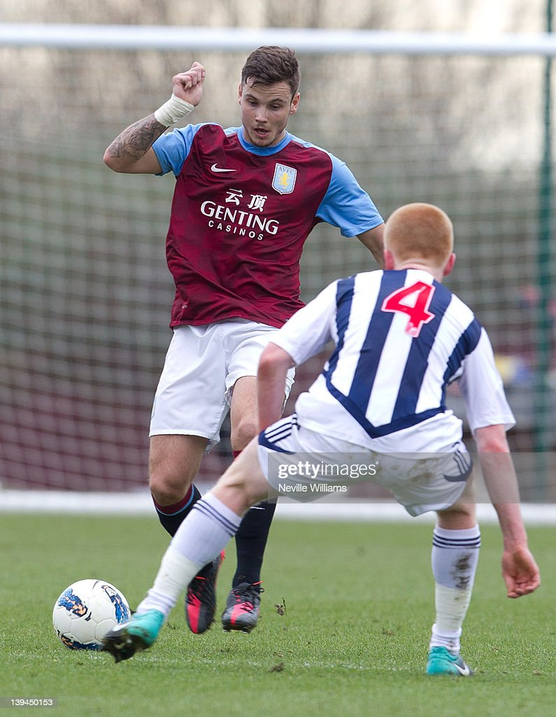 Chris Herd of Aston Villa is challenged by Liam O'Neil of West Bromwich Albion during the Barclays Premier Reserve League match between Aston Villa Reserves and West Bromwich Albion Reserves at the club's training ground at Bodymoor Heath on February 21, 2012 in Birmingham, England.