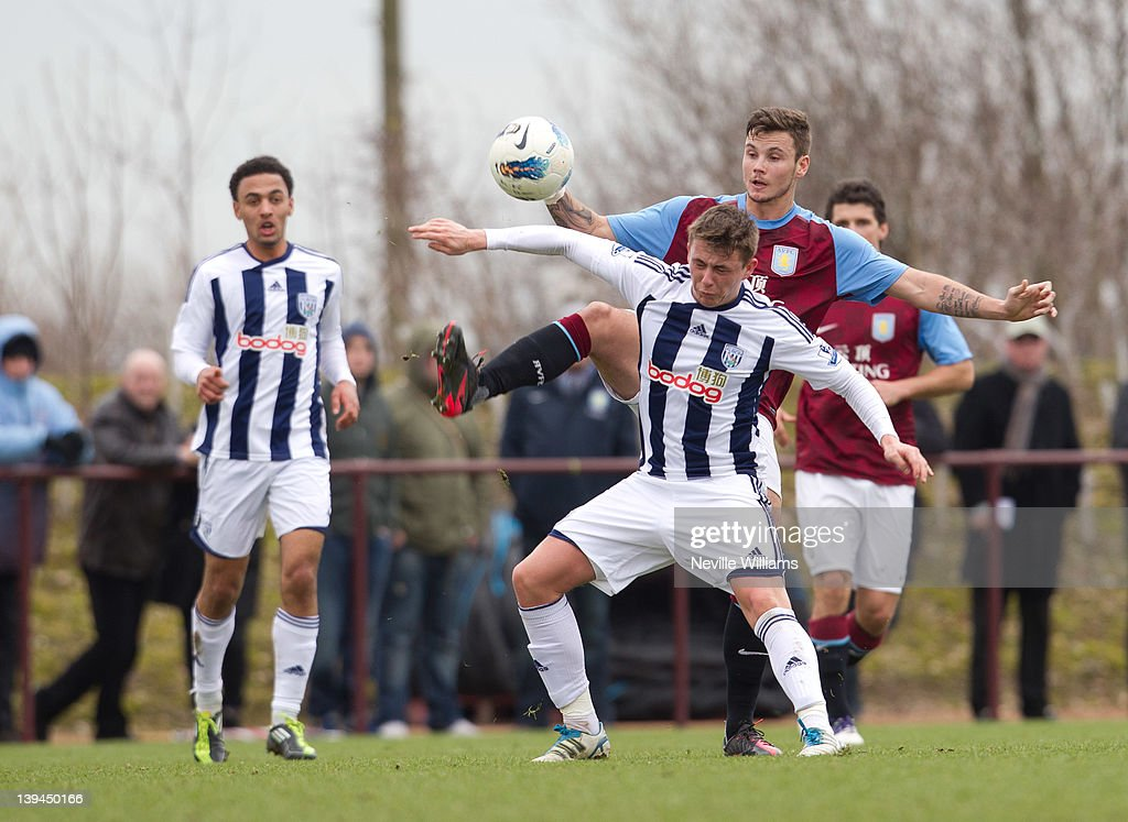 Chris Herd of Aston Villa is challenged by Scott Allan of West Bromwich Albion during the Barclays Premier Reserve League match between Aston Villa Reserves and West Bromwich Albion Reserves at the club's training ground at Bodymoor Heath on February 21, 2012 in Birmingham, England.