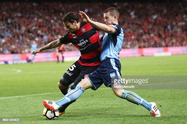 Chris Herd of the Wanderers is tackled by Brandon O'Neill of Sydney FC during the round three ALeague match between Sydney FC and the Western Sydney...