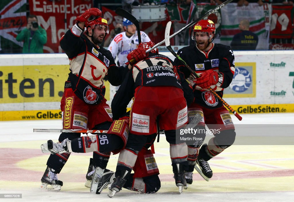 Chris Herperger Andre Reiss and Adam Mitchel of Hannover celebrate their team's 2nd goal during the DEL play off final match between Hannover...