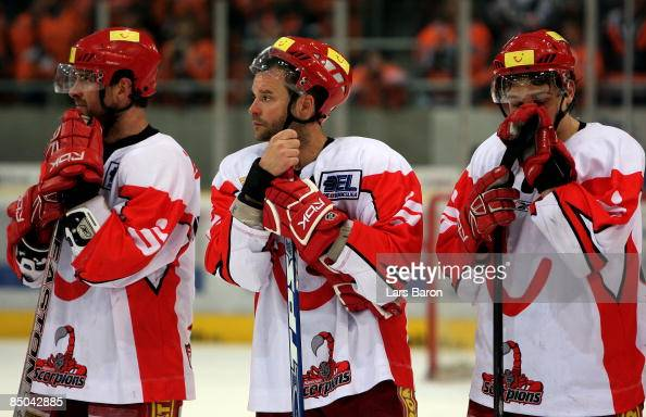 Chris Herperger Tino Boos and Andre Reiss of Hannover are looking dejected after loosing the Cup Final 2008/2009 between Grizzly Wolfsburg and...